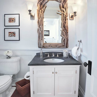 Inspiration for a beach style powder room remodel in New York with an undermount sink, shaker cabinets and white cabinets