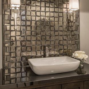 Esempio di un bagno di servizio design con ante con riquadro incassato, ante in legno bruno, piastrelle di vetro, pareti grigie, lavabo a bacinella e top in granito