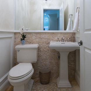 На фото: маленький туалет в стиле современная классика с раздельным унитазом, бежевой плиткой, серой плиткой, белой плиткой, каменной плиткой, белыми стенами, полом из мозаичной плитки, раковиной с пьедесталом и разноцветным полом