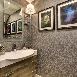 Идея дизайна: маленький туалет в стиле современная классика с фасадами островного типа, унитазом-моноблоком, серыми стенами, монолитной раковиной, столешницей из искусственного камня и желтыми фасадами