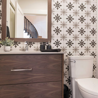 This is an example of a small classic cloakroom in Vancouver with flat-panel cabinets, dark wood cabinets, a one-piece toilet, multi-coloured tiles, ceramic tiles, white walls, vinyl flooring, a submerged sink, engineered stone worktops, beige floors and grey worktops.