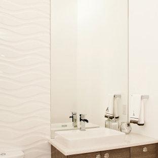 На фото: маленький туалет с плоскими фасадами, коричневыми фасадами, унитазом-моноблоком, белой плиткой, керамогранитной плиткой, белыми стенами, светлым паркетным полом, настольной раковиной, столешницей из кварцита, серым полом и белой столешницей с