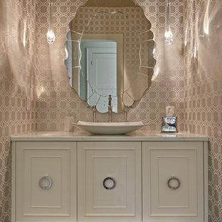 Idées déco pour un WC et toilettes classique de taille moyenne avec un placard à porte affleurante, des portes de placard blanches, des dalles de pierre, un mur beige, une vasque, un plan de toilette en marbre, un WC suspendu et un sol en bois foncé.