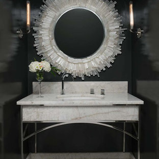 Example of a tuscan marble floor powder room design in Dallas with black walls, an undermount sink and marble countertops