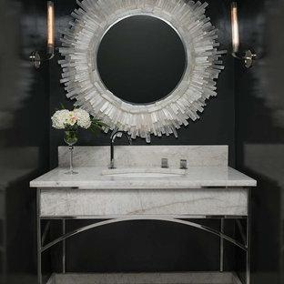 Ispirazione per un bagno di servizio mediterraneo con pareti nere, pavimento in marmo, lavabo sottopiano e top in marmo