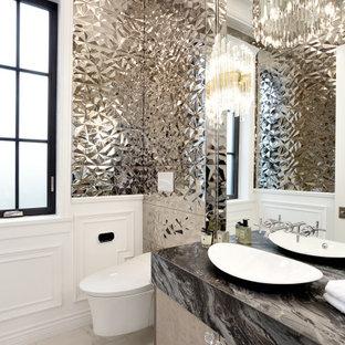 バンクーバーの小さいコンテンポラリースタイルのおしゃれなトイレ・洗面所 (フラットパネル扉のキャビネット、中間色木目調キャビネット、ビデ、ベージュのタイル、セラミックタイル、ベージュの壁、磁器タイルの床、ベッセル式洗面器、クオーツストーンの洗面台、白い床、グレーの洗面カウンター、フローティング洗面台、格子天井) の写真