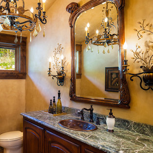 Design ideas for a traditional cloakroom in Minneapolis with a built-in sink, raised-panel cabinets, medium wood cabinets, marble worktops, multi-coloured walls, slate flooring and green worktops.