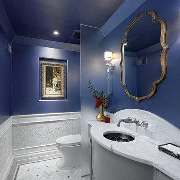 Blue and White Mediterranean powder room in Alexandria, VA