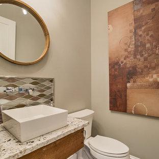 Inspiration pour un WC et toilettes marin avec un placard à porte shaker, un WC séparé, un sol en brique et une vasque.