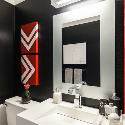 Example of a small minimalist powder room design in Toronto with black walls
