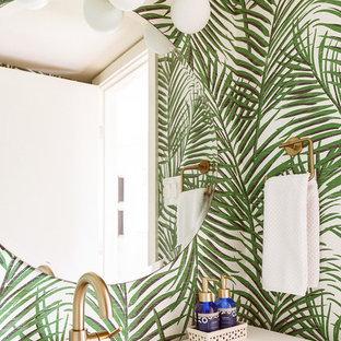 Ejemplo de aseo vintage, pequeño, con armarios tipo mueble, puertas de armario de madera oscura, paredes verdes, suelo de travertino, lavabo integrado, encimera de acrílico, suelo beige y encimeras blancas