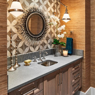 Photo of a mediterranean cloakroom in Austin with recessed-panel cabinets, light wood cabinets, multi-coloured tiles, brown walls, a submerged sink, grey floors and grey worktops.