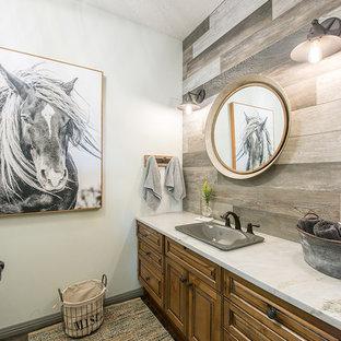 На фото: с высоким бюджетом туалеты среднего размера в стиле рустика с фасадами с выступающей филенкой, искусственно-состаренными фасадами, раздельным унитазом, разноцветной плиткой, керамической плиткой, белыми стенами, паркетным полом среднего тона, накладной раковиной, столешницей из кварцита, серым полом и белой столешницей