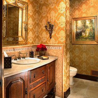 Mediterrane Gästetoilette mit Einbauwaschbecken, verzierten Schränken, dunklen Holzschränken, farbigen Fliesen, Mosaikfliesen, bunten Wänden, Travertin, Travertin-Waschtisch und Toilette mit Aufsatzspülkasten in Los Angeles