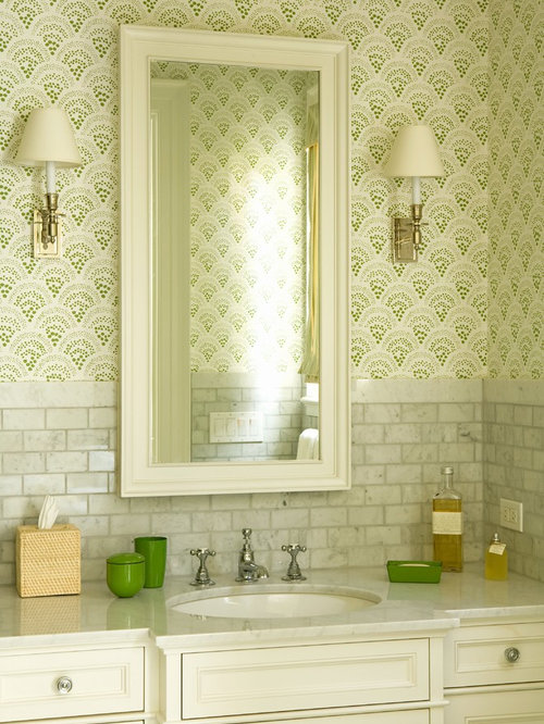 Elegant gray tile and marble tile powder room photo in Los Angeles with  recessed-panel
