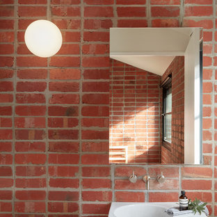 Scandinavian powder room in Melbourne with red walls, an integrated sink and white benchtops.