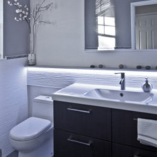 Modern Powder Room by Clever Home Design LLC