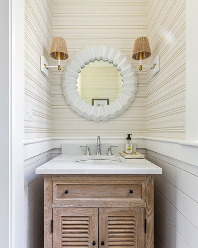 Beach Style Powder Room by Cutting Edge Homes Inc.
