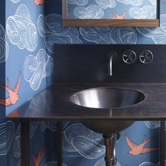 eclectic powder room by Incorporated