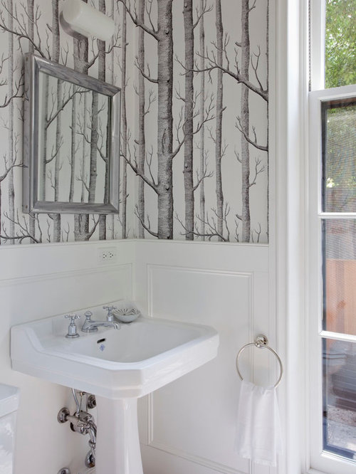 midsized powder room idea in new york with a pedestal sink and