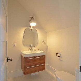 トロントの中サイズのラスティックスタイルのおしゃれなトイレ・洗面所 (フラットパネル扉のキャビネット、茶色いキャビネット、一体型トイレ、白い壁、磁器タイルの床、一体型シンク、クオーツストーンの洗面台、白い床、白い洗面カウンター) の写真