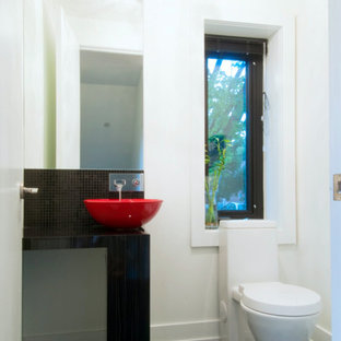 Inspiration for a medium sized contemporary cloakroom in Toronto with open cabinets, a one-piece toilet, black tiles, mosaic tiles, white walls, slate flooring and a vessel sink.