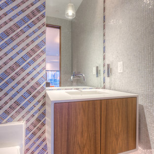 Inspiration for an expansive modern cloakroom in Kansas City with an integrated sink, flat-panel cabinets, light wood cabinets, quartz worktops, a one-piece toilet, multi-coloured tiles, mosaic tiles, white walls and ceramic flooring.