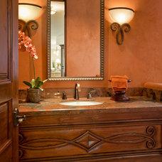 Mediterranean Powder Room by LMK Interiors LLC