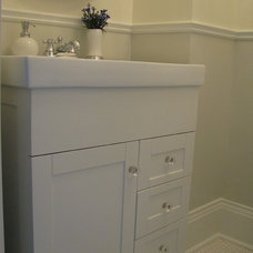 Traditional Powder Room by HARDROCK CONSTRUCTION