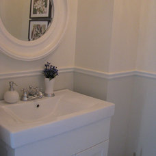 Traditional Powder Room by Sandra Howie