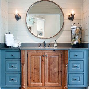 Immagine di un bagno di servizio stile marinaro di medie dimensioni con pavimento in mattoni, ante a filo, ante in legno scuro, piastrelle bianche, pareti bianche, lavabo sottopiano, top in quarzo composito, pavimento rosso e top grigio
