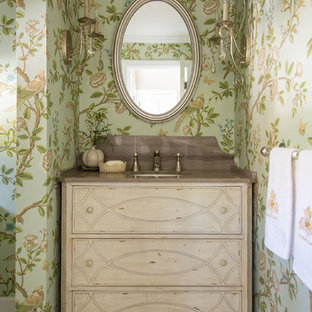 This is an example of a shabby-chic style powder room in Los Angeles with an undermount sink, furniture-like cabinets, light wood cabinets, green walls, ceramic floors, marble benchtops and brown benchtops.
