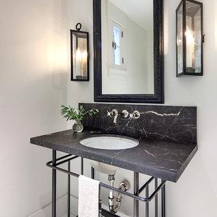 Country Gästetoilette mit Unterbauwaschbecken, Porzellan-Bodenfliesen, weißer Wandfarbe und grauer Waschtischplatte in Santa Barbara