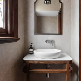 Inspiration for a mediterranean powder room in Melbourne with open cabinets, medium wood cabinets, beige walls, a vessel sink, multi-coloured floor, white benchtops and a built-in vanity.