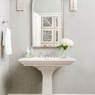 Inspiration for a traditional cloakroom in Charlotte with grey walls, dark hardwood flooring, a pedestal sink and brown floors.