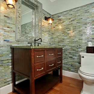 Coastal cloakroom in Boston with freestanding cabinets, dark wood cabinets, marble worktops, multi-coloured tiles and green worktops.