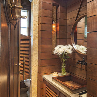 Beach style beige tile powder room photo in Los Angeles with a vessel sink and medium tone wood cabinets