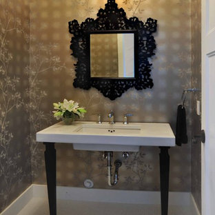 This is an example of a mid-sized victorian powder room in Vancouver with white tile, brown walls, a console sink and white benchtops.