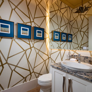 Inspiration for a beach style cloakroom in Miami with recessed-panel cabinets, white cabinets, multi-coloured walls, medium hardwood flooring, a vessel sink and multi-coloured worktops.