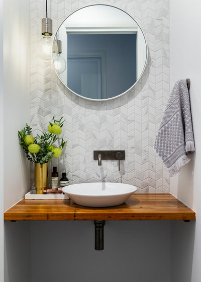 Contemporary Powder Room by Studio Black Interiors