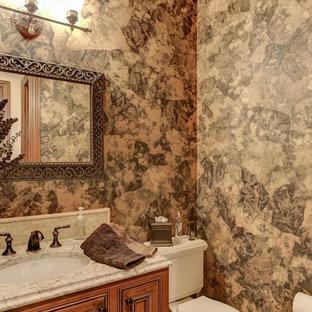 Свежая идея для дизайна: туалет среднего размера в классическом стиле с фасадами с выступающей филенкой, фасадами цвета дерева среднего тона, раздельным унитазом, коричневыми стенами, врезной раковиной, столешницей из гранита и разноцветной столешницей - отличное фото интерьера