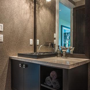 Свежая идея для дизайна: туалет в стиле модернизм с плоскими фасадами и накладной раковиной - отличное фото интерьера