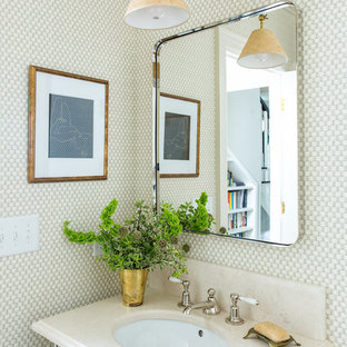Powder room - small traditional white tile powder room idea in Raleigh with beige countertops, white walls, a console sink and quartz countertops