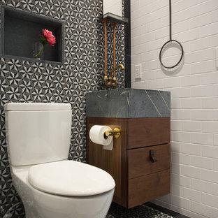 Пример оригинального дизайна: туалет среднего размера в викторианском стиле с разноцветной плиткой, плиткой мозаикой, серым полом, плоскими фасадами, темными деревянными фасадами, раздельным унитазом, разноцветными стенами, полом из керамической плитки, монолитной раковиной, столешницей из бетона и серой столешницей