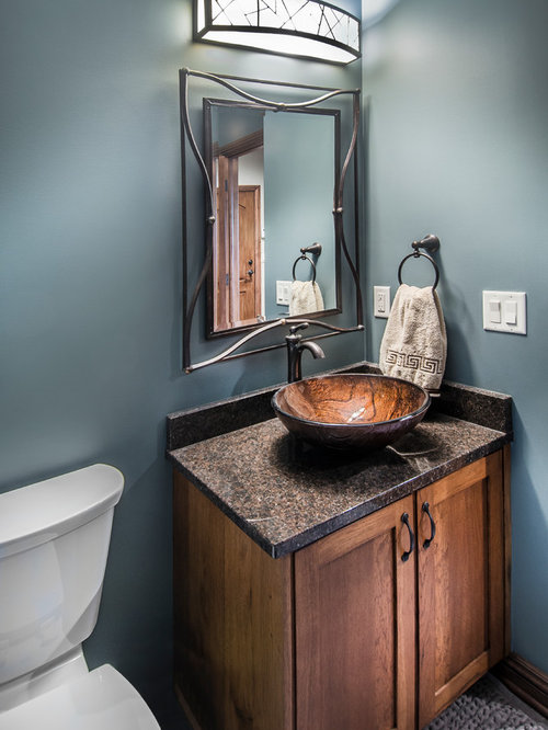 30 Powder Room With A Pedestal Sink And Dark Wood Cabinets