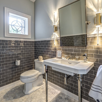 Inspiration for a transitional gray tile gray floor powder room remodel in Other with gray walls, a console sink and a one-piece toilet