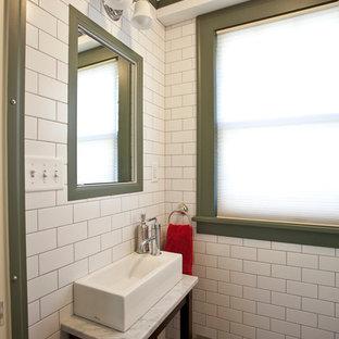 Cette photo montre un WC et toilettes chic avec une vasque, un placard en trompe-l'oeil, des portes de placard en bois sombre, un carrelage blanc, un carrelage métro, un sol en bois brun et un plan de toilette blanc.