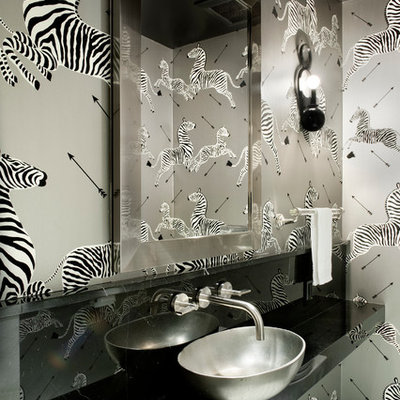 Trendy powder room photo in New York with a vessel sink and gray walls