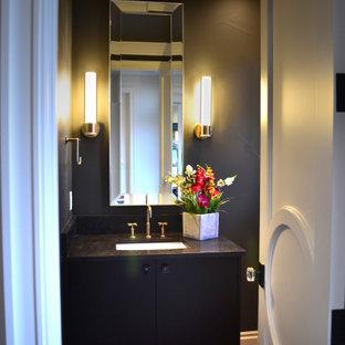 На фото: большой туалет в стиле современная классика с плоскими фасадами, черными фасадами, серыми стенами, паркетным полом среднего тона, врезной раковиной, столешницей из гранита, коричневым полом и черной столешницей с