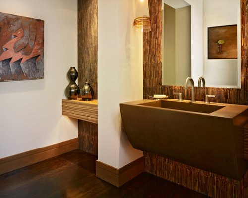 Inspiration for a rustic powder room remodel in Denver with an ...